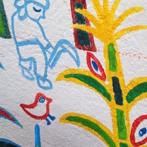 絵の中には、グアテマラの生活が描かれています